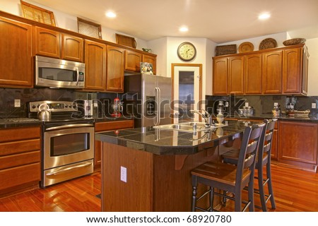 Cabinets kitchen stocked stock photos images pictures for Floors to match cherry cabinets