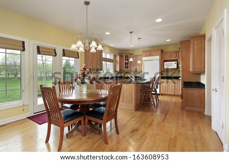 Kitchen with granite island and eating area - stock photo