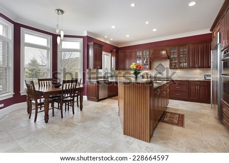 Kitchen with maroon walls and center island - stock photo