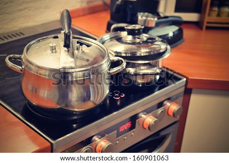 kitchen with stove and pots  - stock photo