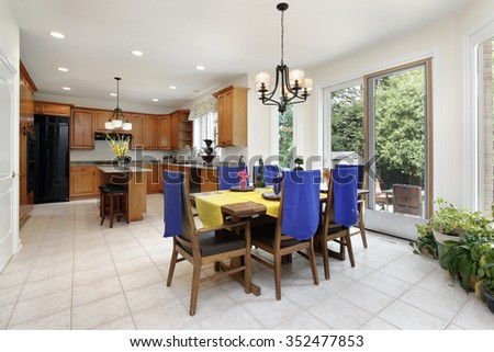 Kitchen with wood cabinetry and eating area - stock photo
