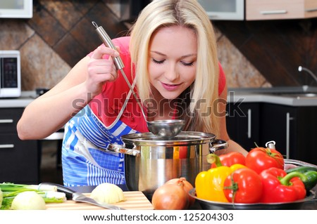 kitchen woman making healthy food standing happy smiling in kitchen preparing salad - stock photo