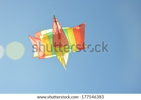 kite flying high in the blue sky - stock photo