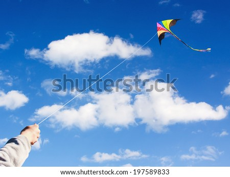 kite flying in a beautiful sky clouds. Focus on the kite - stock photo