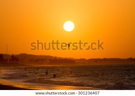 Kite-surf in the sunset light over the ocean - stock photo