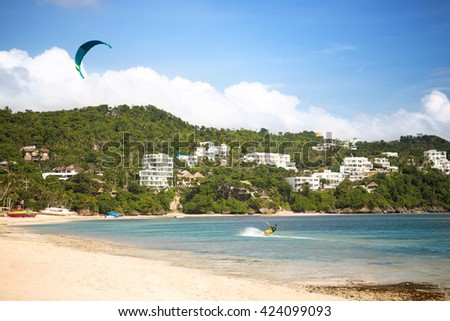 kite surfer surfing on beautiful exotic bay  - stock photo
