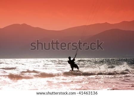 Kite surfers at Skinias beach in Greece. - stock photo