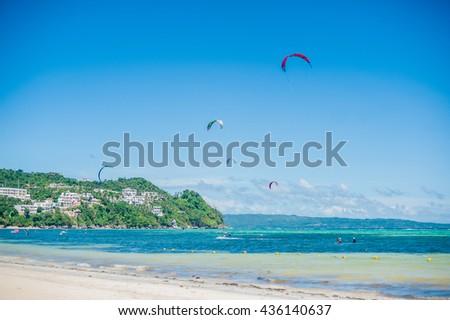 Kite surfers on the island of Boracay - stock photo