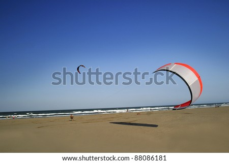 Kite surfing in the air, sea and beach in the Mediterranean - stock photo