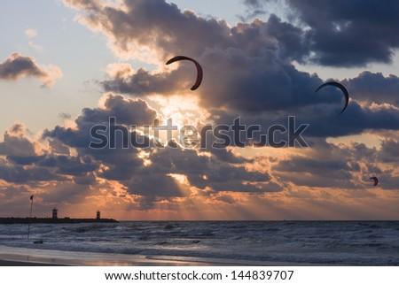Kite surfing in the sunset  at the beach of Scheveningen, the Netherlands - stock photo