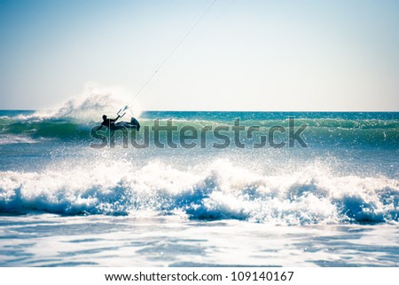 Kite surfing in waves. - stock photo