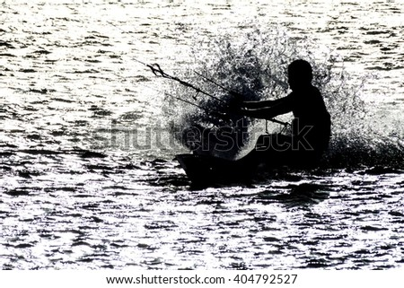 Kitesurfer in a sea near village Cabo de la Vela located on La Guajira peninsula, Colombia - stock photo
