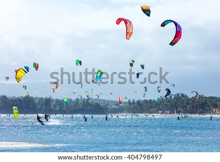 Kitesurfers enjoying wind power on Bulabog beach, Boracay island, Philippines - stock photo