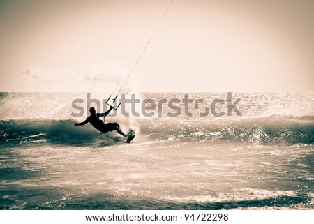 Kitesurfing in Andalusia, Spain. Retro look. - stock photo