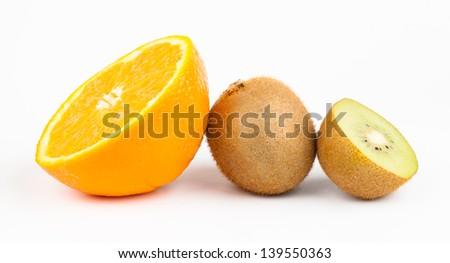 kiwi and orange fruit isolated on white - stock photo