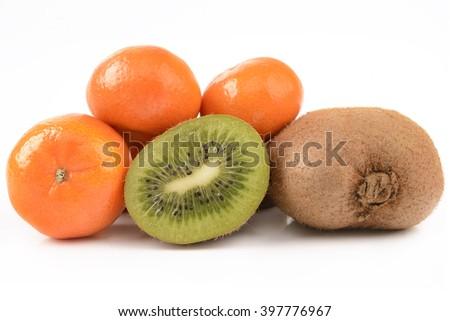 kiwi and tangerines on a white background - stock photo