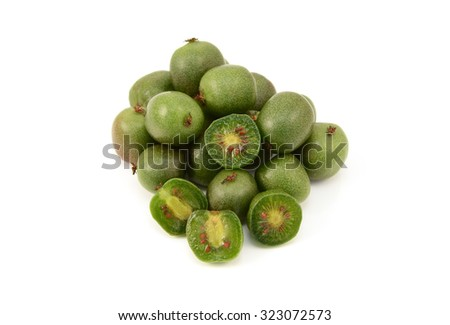 Kiwi berries - whole and sliced in half, isolated on a white background - stock photo