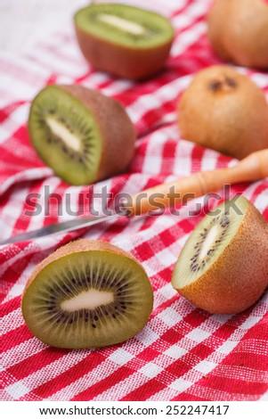 Kiwi fresh cut into pieces. - stock photo