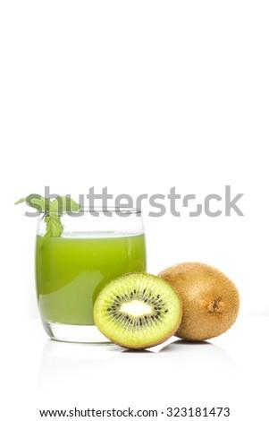 kiwi fruit and kiwi juice on white background - stock photo