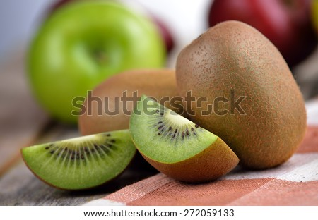 Kiwi fruit on old wooden  - stock photo