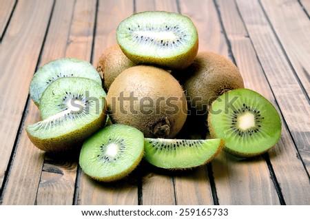 Kiwi fruit on wooden table - stock photo
