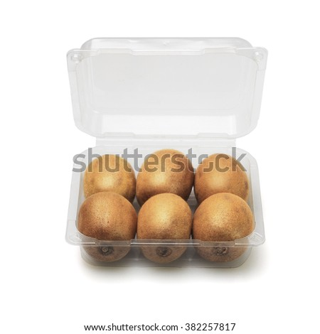 Kiwi Fruits in Open Plastic Container on White Background - stock photo