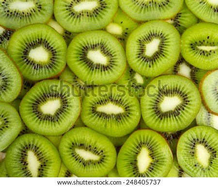 kiwi slices background - stock photo