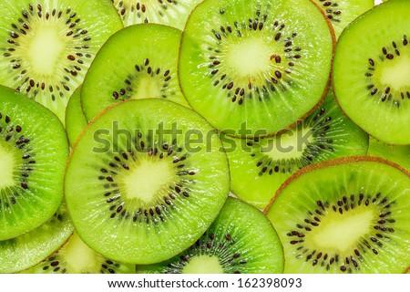 Kiwi slices for background - stock photo