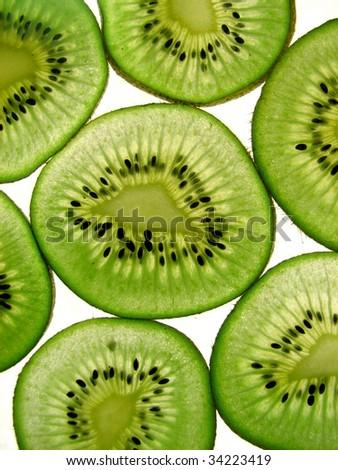Kiwi slices on white background - stock photo