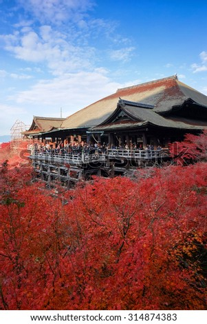 Kiyomizu-dera Temple with red leaves in foreground - stock photo