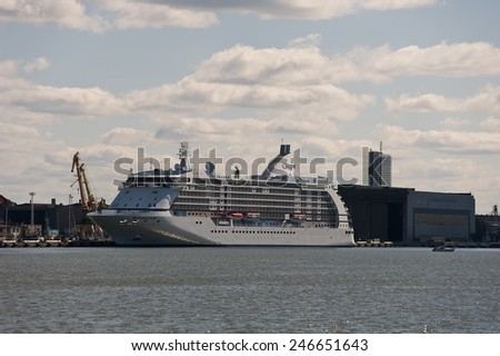 KLAIPEDA,LITHUANIA- AUG 25:cruise liner in port on August 25,2013 in Klaipeda, Lithuania.Seven Seas Voyager is a cruise ship for Regent Seven Seas Cruises headquartered in Miami, Florida.  - stock photo