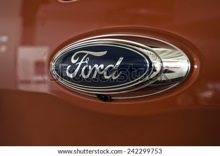 KLAIPEDA,LITHUANIA_ JAN 06:FORD logo on January 06,2015 in Klaipeda, Lithuania.The Ford Motor Company is an American multinational automaker. It was founded by Henry Ford.  - stock photo