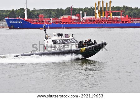 KLAIPEDA,LITHUANIA- JUNE 29:Coast Guard boats patrolling in Klaipeda port on June 29,2015 in Klaipeda,Lithuania.  - stock photo