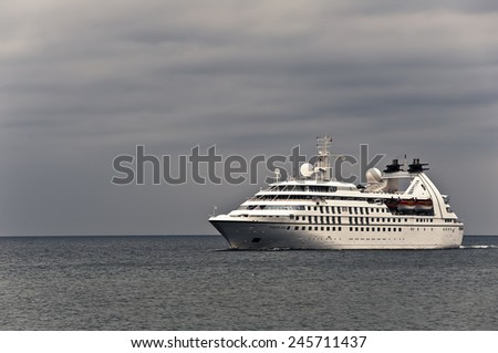 KLAIPEDA,LITHUANIA-JUNE 21:cruise liner SEABOURN PRIDE in the Baltic sea on June 21,2012 in Klaipeda,Lithuania. SEABOURN PRIDE is one of three German built cruise ships. - stock photo