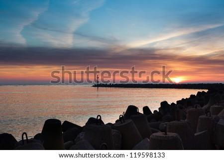 Klaipeda port's gate at sunset - stock photo