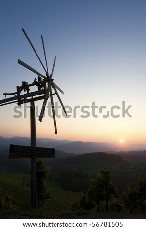 Klapotetz in Austrian vineyards with beautiful landscape at sunset. - stock photo