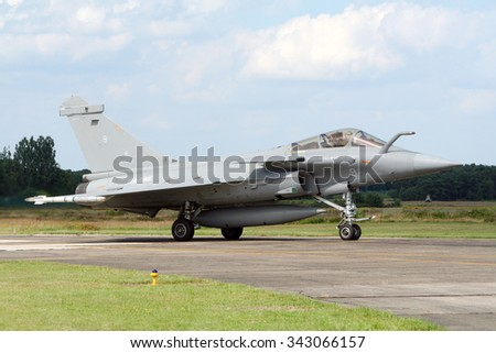 KLEINE BROGEL, BELGIUM - JUL 17, 2007: French Navy Dassault Rafale taxiing after before take-off. - stock photo