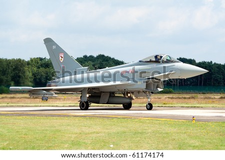 KLEINE BROGEL, BELGIUM - JULY 17: Royal Air Force Eurofighter Typhoon taxiing after a mission during the COMAO exercise and Belgium Spotterday on July 17, 2007 in Kleine Brogel, Belgium - stock photo