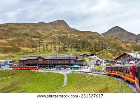 KLEINE SCHEIDEGG, SWITZERLAND - NOV 15, 2014: The Jungfrau railway is a metre gauge rack railway which runs 9 km from Kleine Scheidegg to the highest railway station in Europe at Jungfraujoch.  - stock photo