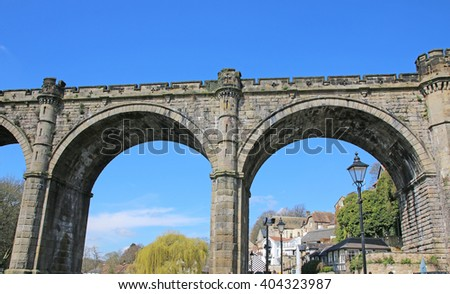 KNARESBOROUGH, UK - APRIL 10, 2016:The railway viaduct above the River Nidd, Knaresborough, North Yorkshire during early spring - stock photo