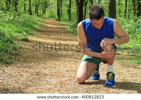 Knee injury, Man runner with knee pain - stock photo