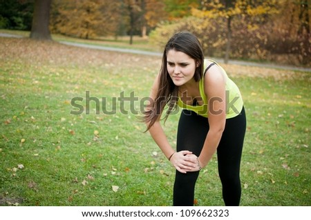 Knee injury - woman in pain after sport - stock photo
