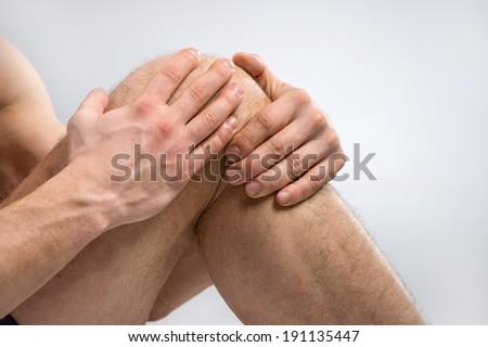 Knee Pain. Man suffering from knee pain. - stock photo