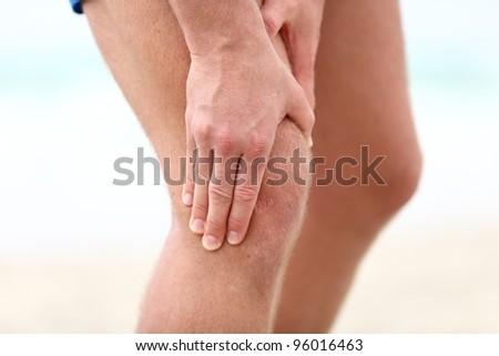 Knee Pain. Sports running knee injury in male runner. - stock photo