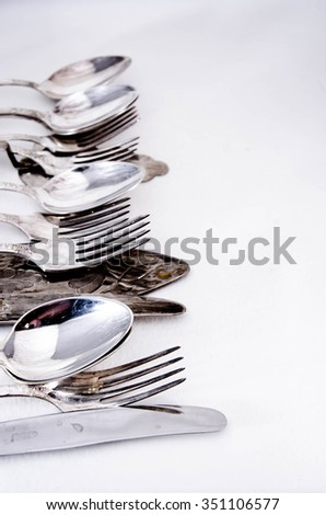 Knife and fork isolated on white background - stock photo
