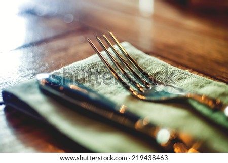 Knife and fork set on a wooden vintage table. Selective Focus - stock photo
