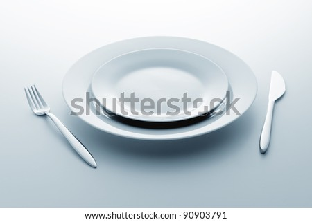 knife fork and plate - stock photo