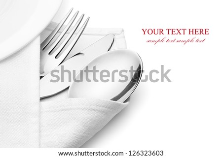 Knife, fork and spoon with linen serviette, isolated on the white background, clipping path included. - stock photo