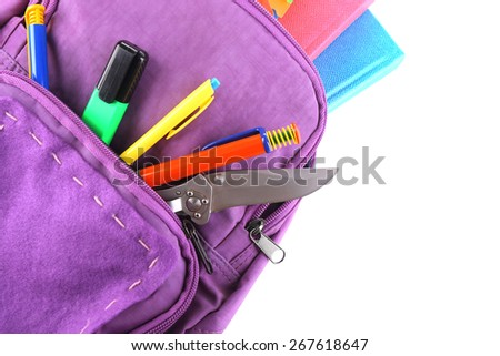 Knife in school backpack, isolated on white - stock photo