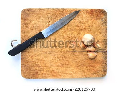knife on a cutting board - stock photo